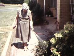 Old Lady Waters Garden (Archive Footage) 1980s Stock Footage