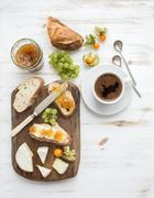 Breakfast set. Brie cheese and fig jam sandwiches with fresh grapes, ground c - stock photo