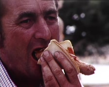 Man Eats Sausage & Fair Ground Scenes (1980s Archival Footage) Stock Footage
