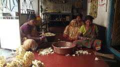 Indian women working making flower petals Stock Footage