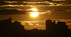 View of the city at sunrise. Golden sky - stock footage