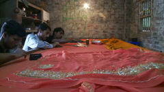 Three Indian men working on a tapestry. Stock Footage