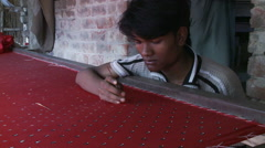 Close up view of mans hand sewing sequins on fabric Stock Footage