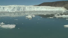 Handheld pan of a glacier front and icy waters Stock Footage