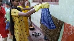 Indian girl showing batik material Stock Footage
