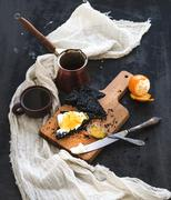 Breakfast set. Black bread toasts with tangerine marmelade and mascarpone che Stock Photos