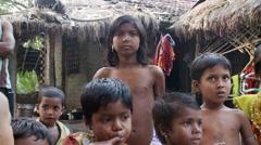 Indian children near jungle hut Stock Footage
