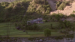 Homes at the base of mountains in India Stock Footage