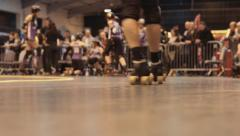 Skaters Skate Past at Roller Derby, Close Up - stock footage