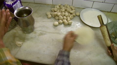 Two men rolling out dough with rolling pin Stock Footage