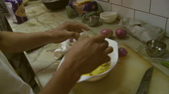 Man cracks two eggs into bowl Stock Footage