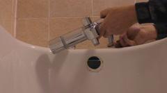 Plumber working in the bathroom - stock footage
