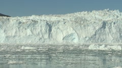 Handheld still of glacier front and water with ice debris Stock Footage