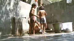 Low angle shot of boys washing Stock Footage