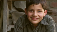 Boy smiling brown eyes brown hair Stock Footage