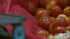 Closeup view of red tomatoes on sack Stock Footage