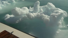 Still of floating Arctic ice next to side of boat Stock Footage