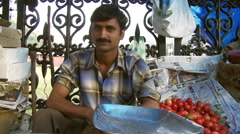Male vendor close up in market in India Stock Footage