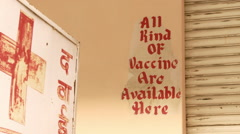 All kinds of vaccines are available here sign next to red cross sign Stock Footage