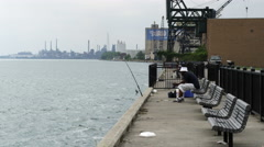 A few men fishing from the wharf in Detroit. Stock Footage