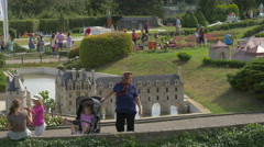 Walking and taking pictures of the Chenonceaux at the Mini-Europe, Brussels Stock Footage
