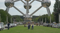 Tourists walking under the Atomium in Brussels Stock Footage