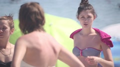Girl in swimsuit with a towel on his shoulders standing on sea background Stock Footage