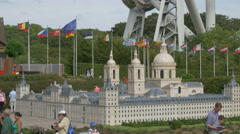 People walking next to the Monastery of San Lorenzo at the Mini-Europe, Brussels Stock Footage