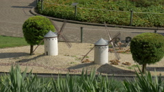 Train passing by the White Windmills from La Mancha at the Mini-Europe, Brussels - stock footage