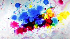 Color Ink drops and splatters on white background Stock Footage