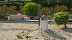 Train passing by a White Windmill of La Mancha at the Mini-Europe, Brussels - stock footage