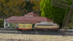 Trains passing by a train station of La Mancha at the Mini-Europe, Brussels - stock footage