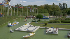 People admiring a port displayed at the Mini-Europe, Brussels Stock Footage