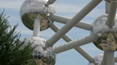 View of a green tree near the Atomium in Brussels Stock Footage