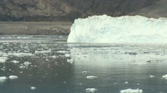 Pan along a glacier front and the icy ocean Stock Footage