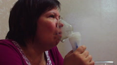 Woman with inhalation mask Stock Footage