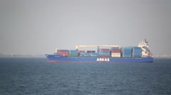 Barge loaded with large containers slowly comes into port Stock Footage