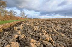 agricultural landscape under dramatic Sky - stock photo