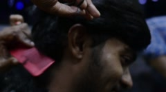 Indian man getting his hair cut Stock Footage