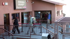 People enter a Teleferico cable car lower station at early morning. Tenerife Stock Footage