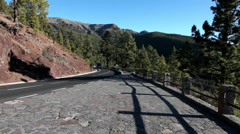Touristic passenger bus and small cars drive on mountain road TF-21. Tenerife Stock Footage