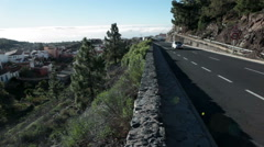 Small car drives on the mountain road TF-21 in Vilaflor village. Tenerife Stock Footage