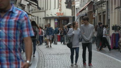 Couple and other people walking on Rue de l'Etuve in Brussels Stock Footage