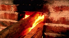 firewood burning in an old style stove 4K - stock footage