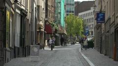 Walking on the cobblestone Etuve Street in Brussels Stock Footage