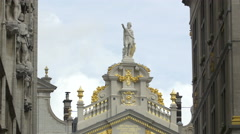 Building with a statue on top and golden details in Brussels Stock Footage
