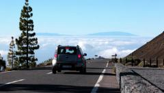 High mountain asphalt road is over clouds. Driving car, Canaries islands, Spain Stock Footage