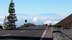Car driving away in turn on the road TF-38. Route from Teide, Tenerife vo Stock Footage