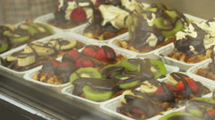 Fruits with chocolate displayed in a shop window in Brussels Stock Footage