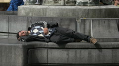 Man sleeping on Charles Buls fountain in Brussels Stock Footage